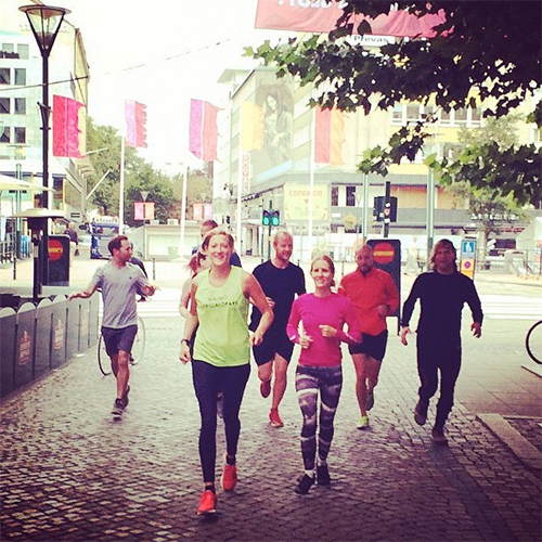 Participants at The Conference, a media event in Malmö, jogging with Malmö Guerrilla Runners.