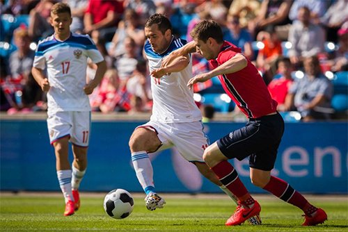 Disquiet immediately greeted the announcement of Russia's successful bid for the 2018 FIFA World Cup.. (Russia forward Kershakov dribbles the ball.)