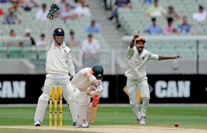 David Warner of Australia looks down after getting LBW by Ravichandran Ashwin of India, on the fourth day of the Boxing Day test against India at the MCG in Melbourne, Monday, Dec. 29, 2014. (AAP Image/Joe Castro) NO ARCHIVING, EDITORIAL USE ONLY, IMAGES TO BE USED FOR NEWS REPORTING PURPOSES ONLY, NO COMMERCIAL USE WHATSOEVER, NO USE IN BOOKS WITHOUT PRIOR WRITTEN CONSENT FROM AAP