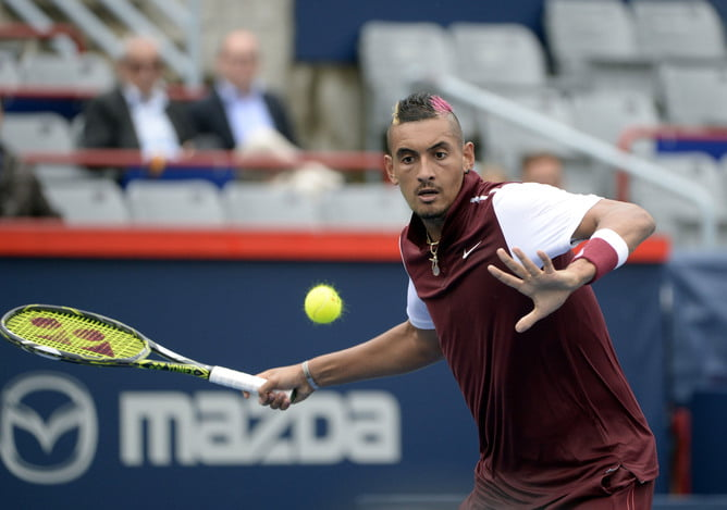 Aug 11, 2015; Montreal, Quebec, Canada; Nick Kyrgios of Australia hits the ball against Fernando Verdasco of Spain (not pictured) during the Rogers Cup tennis tournament at Uniprix Stadium. Mandatory Credit: Eric Bolte-USA TODAY Sports - RTX1NYZK
