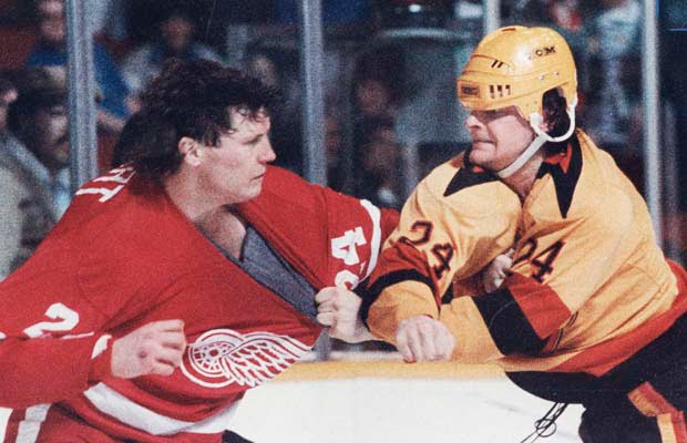 VANCOUVER, BC. MARCH 11, 1987 -- Vancouver Canucks Michel Petit and Detroit Red Wings Bob Probert exchange punches during NHL action at the Pacific Coliseum filed March 11, 1987. (Steve Bosch/Vancouver Sun) [PNG Merlin Archive]