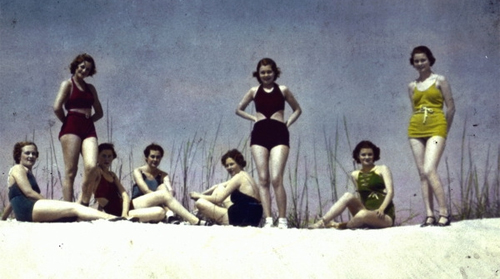 Young women posing in swimsuits on sand dune, glass lantern slide, 1940s, Flickr Commons / State Library and Archives of Florida.