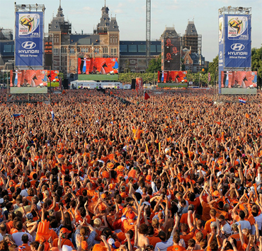 Netherlands fans form a sea of orange as they watch the 2010 World Cup final between Netherlands and Spain on a large screen near the Rijksmuseum on July 11, 2010 in Amsterdam, Netherlands. (Christopher Lee/Getty Images)