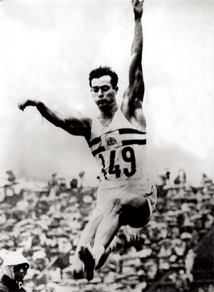 Lynn Davies wins the long jump gold medal at the Tokyo Olympics, 1964.