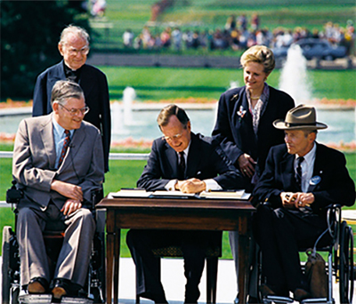 President George Bush signing the ADA in 1990.