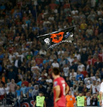 Match officials abandoned Tuesday's Euro 2016 qualifier between Albania and Serbia after a drone carrying an Albanian flag entered the stadium late in the first half and sparked a brawl between players and fans.